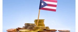 Staggered by a $72 billion debt load, Puerto Rico's government said Friday it would not make a $58 million bond payment due Saturday, setting the stage for what could be one of the largest U.S. municipal debt restructurings.